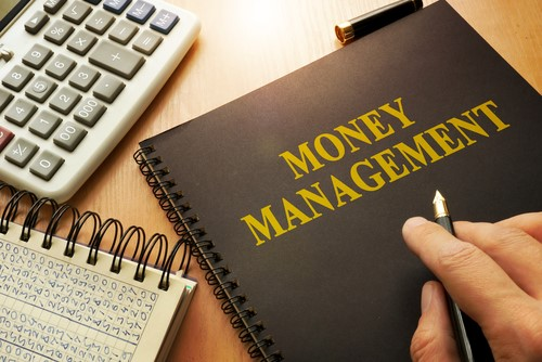 money management notebook and calculator